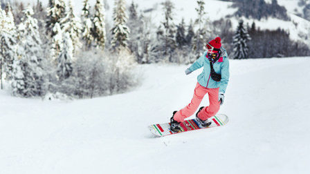 Woman-ski-suit-looks-her-shoulder-going-down-hill-her-snowboard_8353-1057_thumb_main